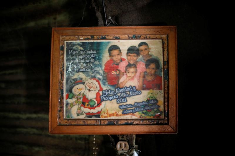 A family photograph hangs in Maria Guitia's home