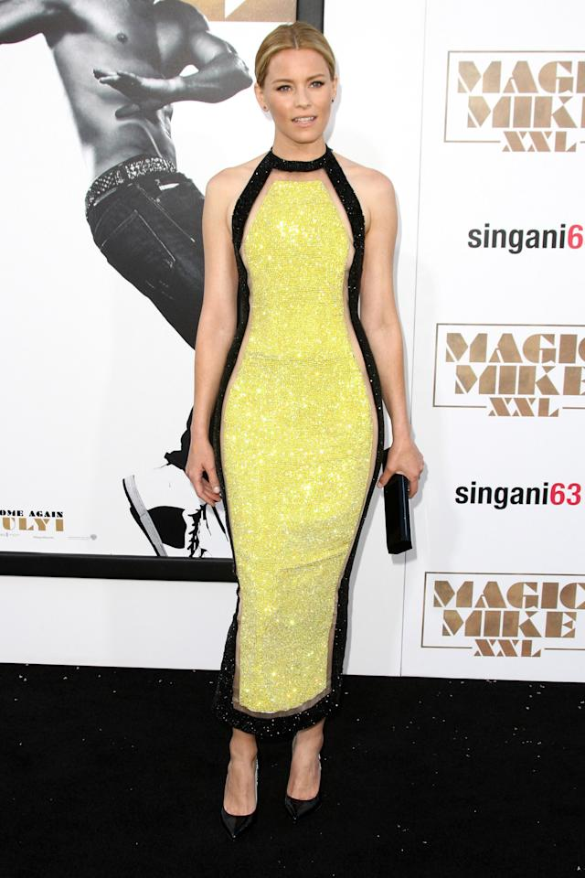 <p>The comedic actress/director proved her fashion mettle by dazzling the black carpet in a sparkly yellow gown by Balmain.<br /><br /></p>