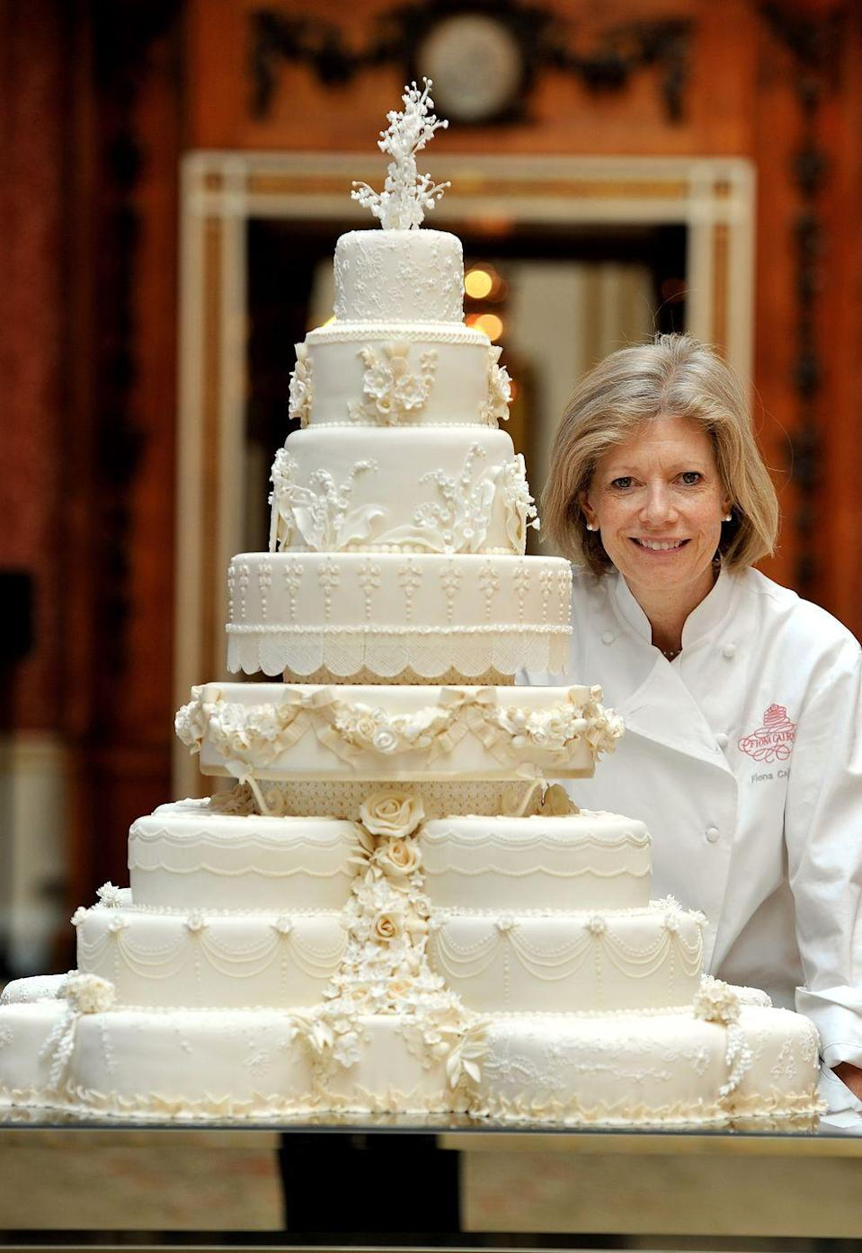"""<p>Pastry chef Fiona Cairns led the charge in creating the eight-layer, 220-pound fruitcake. The <a href=""""https://www.goodhousekeeping.com/food-recipes/a3784/traditional-fruitcake-2202/"""" rel=""""nofollow noopener"""" target=""""_blank"""" data-ylk=""""slk:traditional British flavor"""" class=""""link rapid-noclick-resp"""">traditional British flavor</a> lasts for years (it's often served at later christenings!), but no one ate the final decorated creation that later went on display. Guests actually nibbled at 600 separate slices of fruitcake for breakfast on the morning of the wedding, Cairns told <em><a href=""""https://www.townandcountrymag.com/society/tradition/a19695573/kate-middleton-royal-wedding-cake-baker-fiona-cairns/"""" rel=""""nofollow noopener"""" target=""""_blank"""" data-ylk=""""slk:Town & Country"""" class=""""link rapid-noclick-resp"""">Town & Country</a></em>. </p>"""