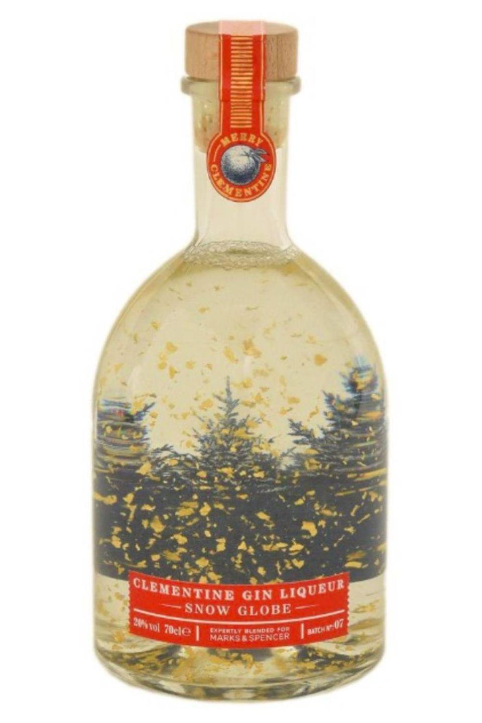 """<p>This Clementine Gin Liqueur Snow Globe is filled with edible 23 carat gold leaf pieces. Yep, 23! Which means when the bottle is turned, the pieces float and create a sparkly, pretty snow globe. And the clementine flavouring just makes this the perfect Christmas gin. </p><p><strong>Available in <a href=""""https://www.marksandspencer.com/c/food-to-order/adventures-in-food/christmas-gin"""" rel=""""nofollow noopener"""" target=""""_blank"""" data-ylk=""""slk:M&S"""" class=""""link rapid-noclick-resp"""">M&S</a> stores </strong></p>"""