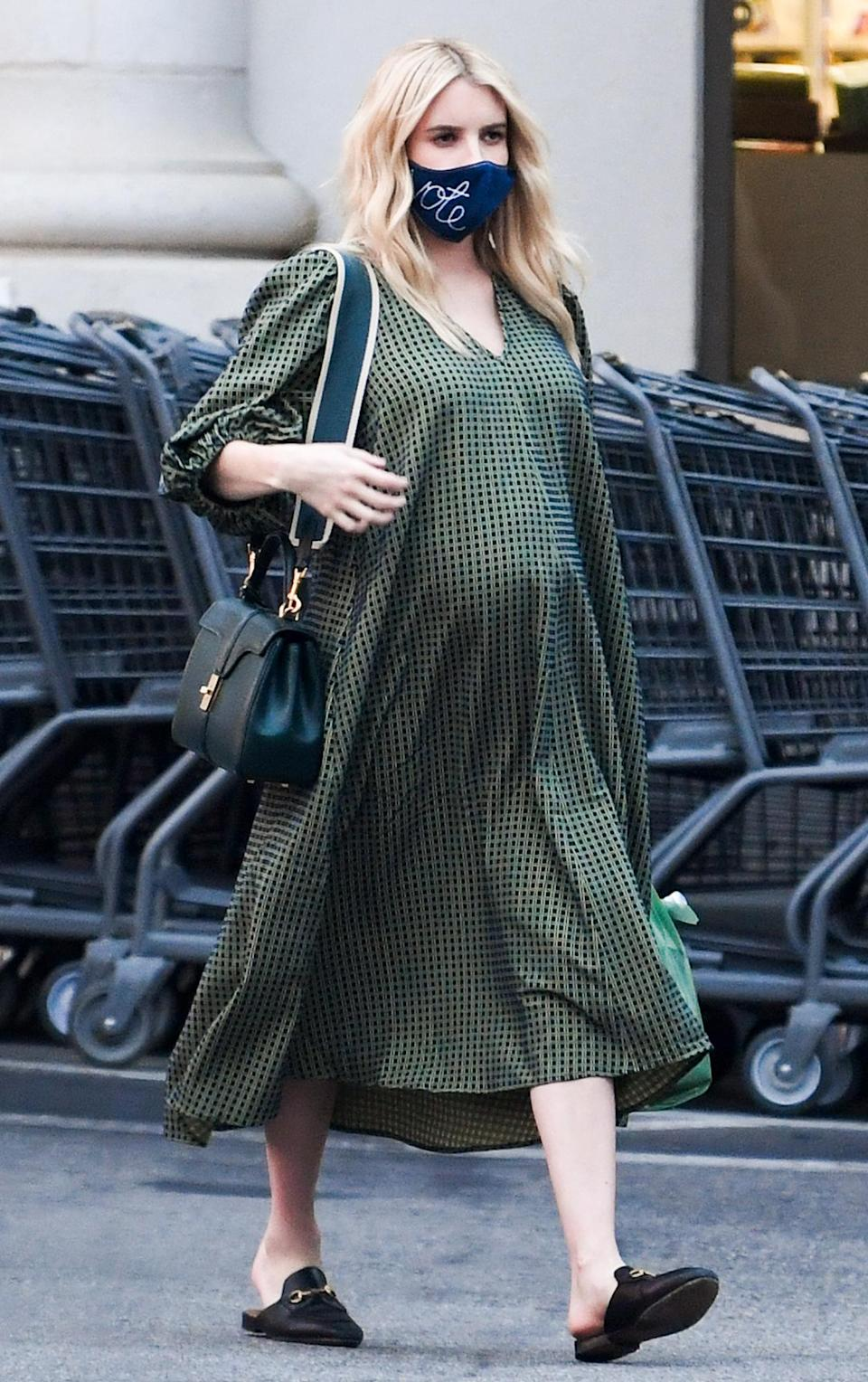 "<p>Emma Roberts is seen in L.A. on Thursday going grocery shopping, wearing a checkered silk dress and a ""vote"" embroidered face mask.</p>"