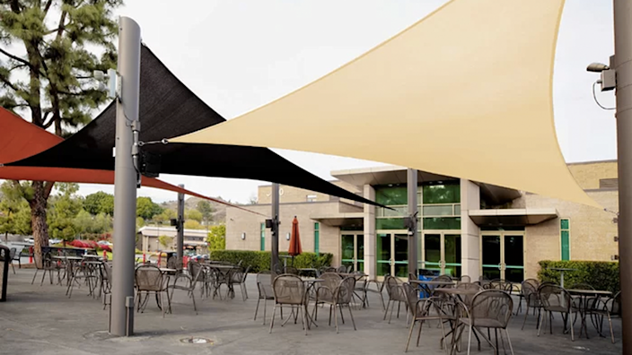 These expansive shade sails remind me of sitting in a cafe on a busy European street