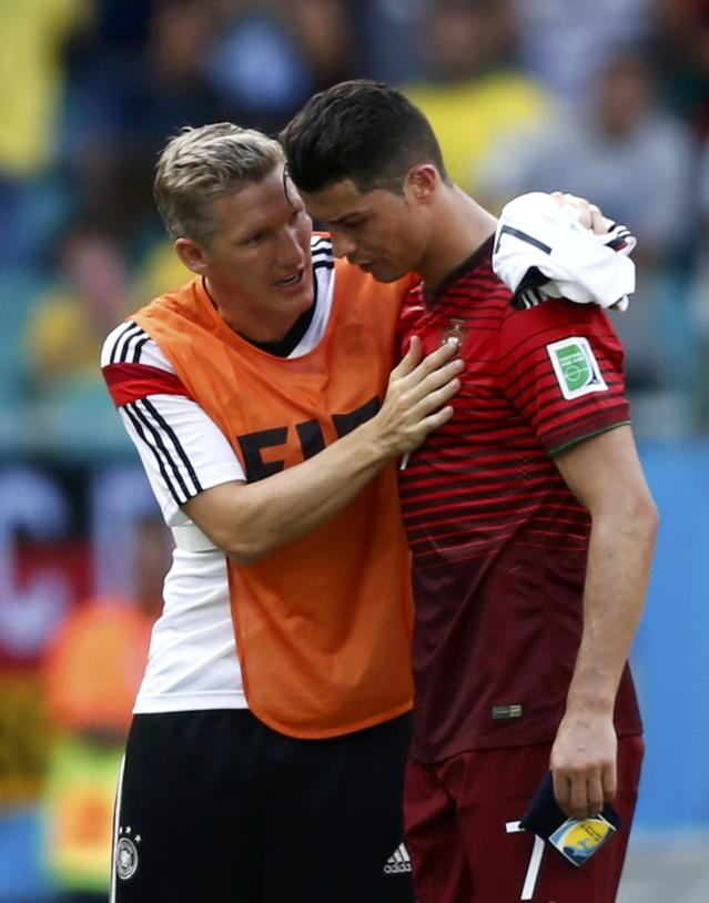 Portugal's Cristiano Ronaldo (R) is comforted by Germany's Bastian Schweinsteiger after their 2014 World Cup Group G soccer match at the Fonte Nova arena in Salvador June 16, 2014. REUTERS/Marcos Brindicci (BRAZIL - Tags: SOCCER SPORT WORLD CUP)