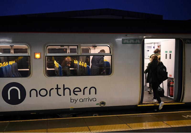 Rail passengers commute on a Northern train, operated by Arriva, a unit of Germany's Deutsche Bahn, as it passes through the train station in Ashton-under-Lyne, northern England, on January 29, 2020. - Britain's government said Wednesday it would take back control of most rail services in northern England after nearly two years of complaints about the private company struggling to serve the region. After Brexit is delivered on Friday, improving infrastructure in northern England has become as key domestic priority for Prime Minister Boris Johnson's government. Transport Secretary Grant Shapps said he would terminate the franchise with Northern, part of the Arriva group owned by German firm Deutsche Bahn, from March 1. (Photo by Oli SCARFF / AFP) (Photo by OLI SCARFF/AFP via Getty Images)