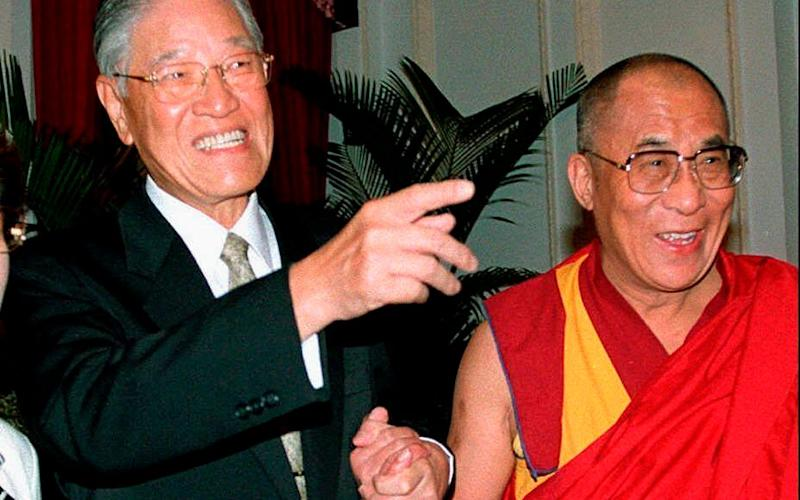 With the Dalai Lama in 1997 - Sam Yeh/AFP