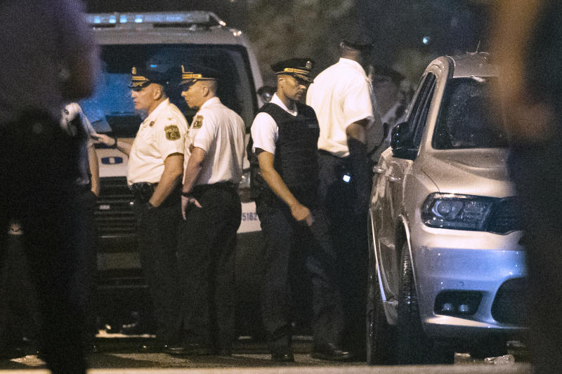 In this Thursday, Aug. 15, 2019 photo Philadelphia Police Commissioner Richard Ross, center right, remains on the scene after a gunman was apprehended following a standoff Philadelphia. The mayor of Philadelphia says on Tuesday, Aug. 20, 2019, that Ross is resigning over new allegations of sexual harassment and racial and gender discrimination against others in the department. Mayor Jim Kenney says that Richard Ross has been a terrific asset to the police department and the city as a whole and that he's disappointed to lose him. (AP Photo/Matt Rourke)