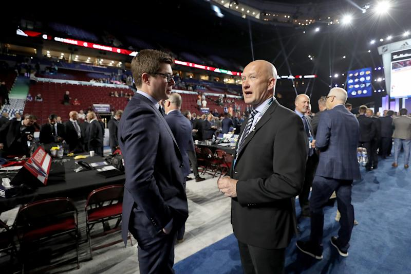 VANCOUVER, BRITISH COLUMBIA - JUNE 22: (L-R) Kyle Dubas of the Toronto Maple Leafs and Jarmo Kekalainen of the Columbus Blue Jackets attend the 2019 NHL Draft at Rogers Arena on June 22, 2019 in Vancouver, Canada. (Photo by Bruce Bennett/Getty Images)