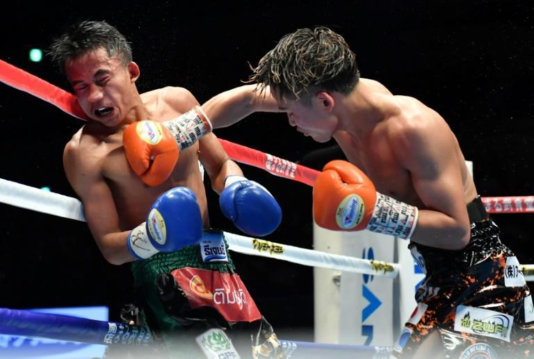 WBA light flyweight boxing champion Hiroto Kyoguchi (R) was due to defend his title on Tuesday