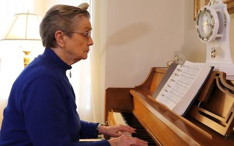 Alzheimer's patient LaVonne Moore is still able to play her favorite hymns on the piano after starting a pilot study with deep brain stimulation. - Credit: Ohio State