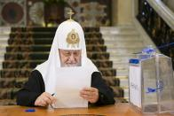 In this photo released by Russian Orthodox Church Press Service, Russian Orthodox Church Patriarch Kirill reads his ballot during the Parliamentary elections in Moscow, Russia, Friday, Sept. 17, 2021. Russia has begun three days of voting for a new parliament that is unlikely to change the country's political complexion. There's no expectation that United Russia, the party devoted to President Vladimir Putin, will lose its dominance in the State Duma. (Oleg Varov/Russian Orthodox Church Press Service via AP)