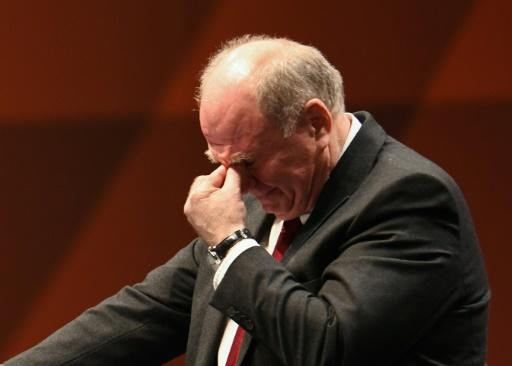 Outgoing Bayern Munich president Uli Hoeness fights back tears as he speaks at the club's annual general meeting on Friday