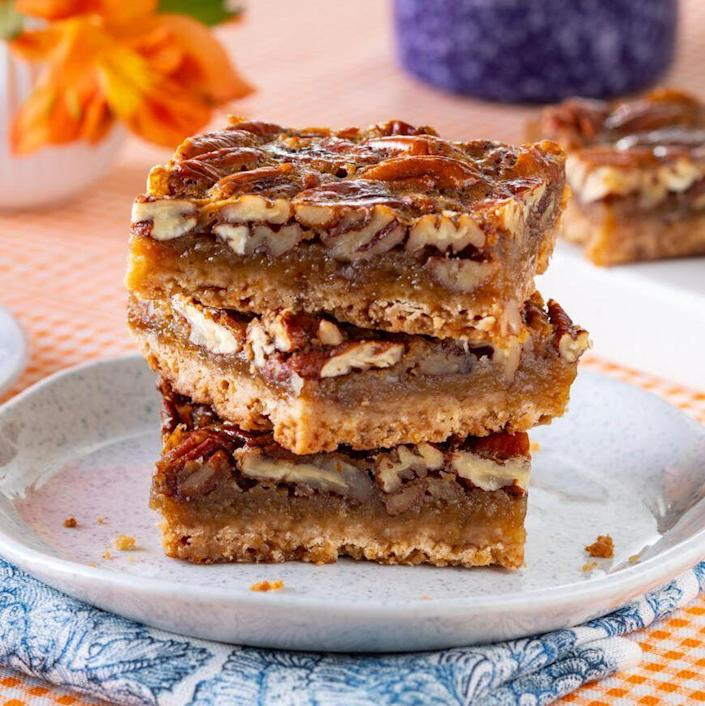 """<p>Easier than pie but still just as ooey-gooey and delicious, these pecan pie bars are sure to become a new favorite. </p><p><a href=""""https://www.thepioneerwoman.com/food-cooking/recipes/a37275756/pecan-pie-bars-recipe/"""" rel=""""nofollow noopener"""" target=""""_blank"""" data-ylk=""""slk:Get the recipe."""" class=""""link rapid-noclick-resp""""><strong>Get the recipe. </strong></a></p><p><a class=""""link rapid-noclick-resp"""" href=""""https://go.redirectingat.com?id=74968X1596630&url=https%3A%2F%2Fwww.walmart.com%2Fsearch%3Fq%3Dpioneer%2Bwoman%2Bbaking%2Bpan&sref=https%3A%2F%2Fwww.thepioneerwoman.com%2Ffood-cooking%2Fmeals-menus%2Fg37691893%2Fwinter-desserts%2F"""" rel=""""nofollow noopener"""" target=""""_blank"""" data-ylk=""""slk:SHOP BAKING PANS"""">SHOP BAKING PANS</a></p>"""