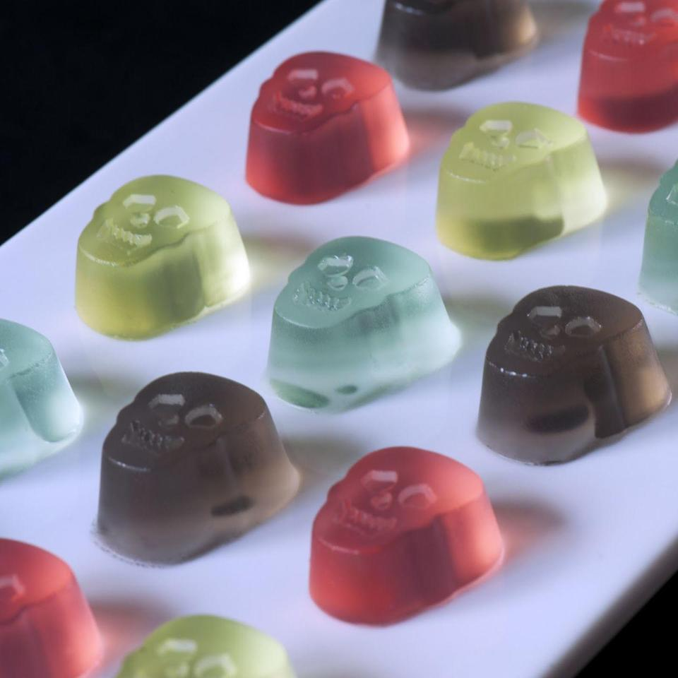 """<p>Bubblegum flavored vodka + skulls=creepy, candy, boozy perfection.</p><p>Get the recipe from <a href=""""http://jelly-shot-test-kitchen.blogspot.com/2011/10/gumball-jelly-shot.html?m=1"""" rel=""""nofollow noopener"""" target=""""_blank"""" data-ylk=""""slk:Jelly Shot Test Kitchen"""" class=""""link rapid-noclick-resp"""">Jelly Shot Test Kitchen</a>.</p>"""