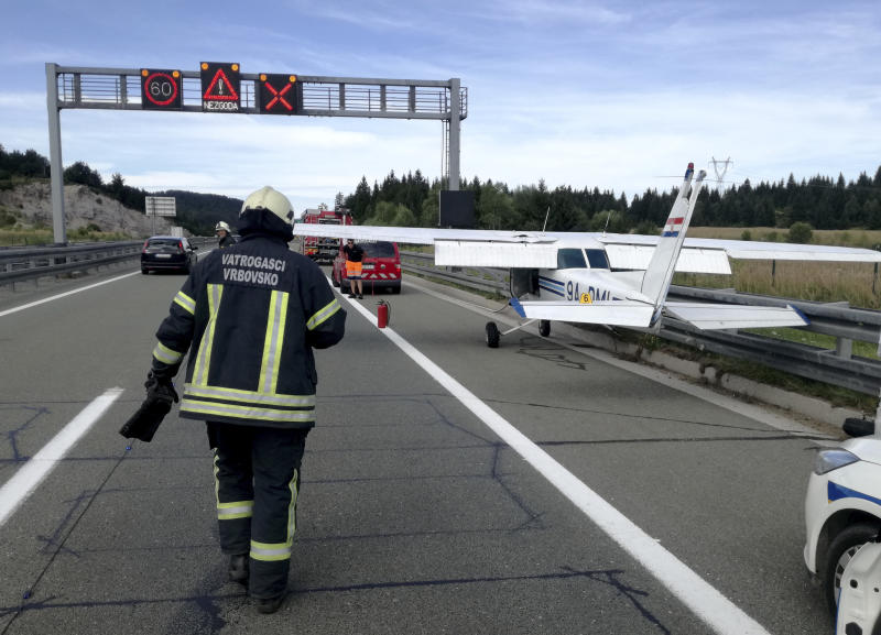 In this photo provided by Vrbovsko Fire Brigade, a small plane is parked after it made an emergency landing on a main highway in Croatia, near Vrbovsko, Saturday, Aug. 17, 2019. Croatian emergency services say the incident happened Saturday on the highway connecting Croatia's capital Zagreb with the northern Adriatic port of Rijeka, usually crowded during the summer tourism season and on weekends. (Filip Marekovic/Vrbovsko Fire Brigade via AP)