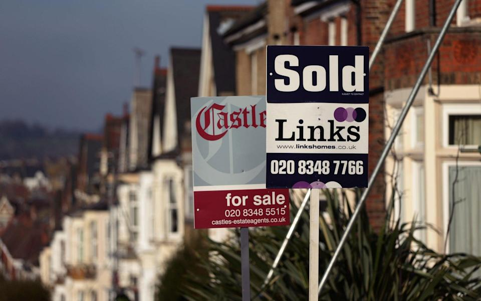 For Sale and Sold signs outside houses in north London - Yui Mok/PA