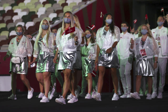 <p>Members of Team Latvia arrive during the opening ceremony in the Olympic Stadium at the 2020 Summer Olympics, Friday, July 23, 2021, in Tokyo, Japan. (Hannah McKay/Pool Photo via AP)</p>