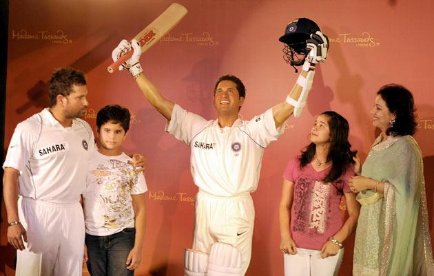 Indian cricketer Sachin Tendulkar (L), along with his son Arjun (2L), daughter Sara (2R) and wife Anjali, poses with his waxwork figure at the unveiling ceremony in Mumbai on April 13, 2009. The figure showing Tendulkar, 35, in a familiar pose -- in full whites of the India team, batting pads, arm guard and gloves, holding his bat and helmet aloft in celebration -- will go on show from Tendulkar's birthday on April 24 at London's Madame Tussaud's Museum. The new waxwork figure of the Indian cricket legend, which is the first of an Indian sportsman at the world famous waxwork attraction, will join figures of other celebrated Indian film personalities Amitabh Bachchan, Aishwarya Rai Bachchan, Shahrukh Khan and Salman Khan. AFP PHOTO/ Indranil MUKHERJEE