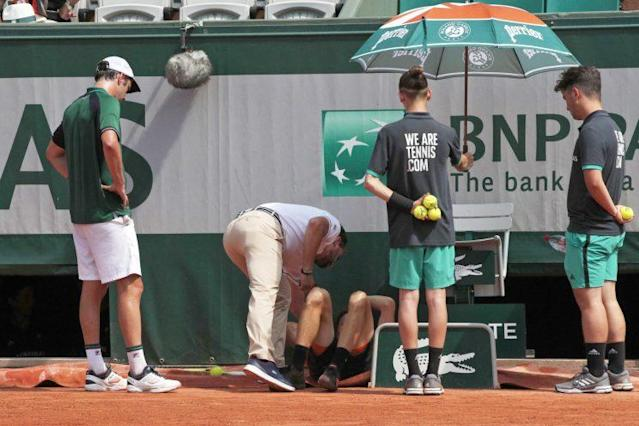 David Goffin was forced to retire after injuring his right ankle. (AP)