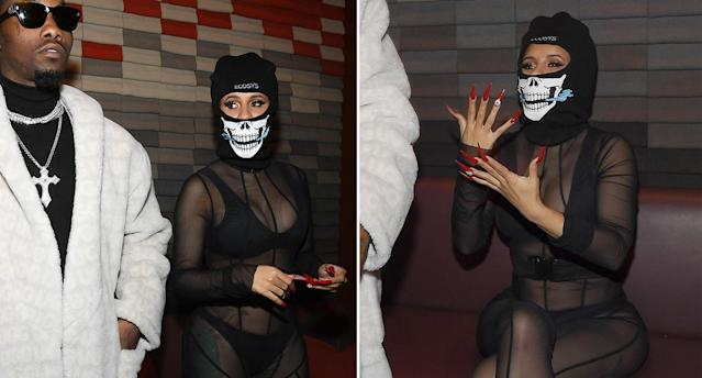 Cardi B wears a sheer bodyshuit and skeleton balaclava. [Photo: Getty]