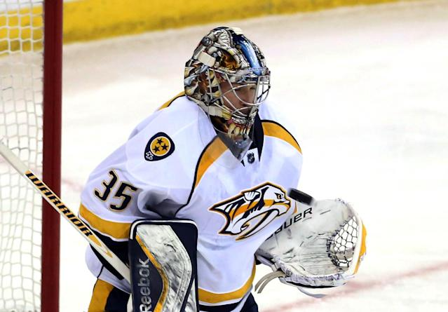 Nashville Predators goaltender Pekka Rinne (35) makes a chest save during the first period of an NHL hockey game against the Ottawa Senators in Ottawa, Monday, March 10, 2014. (AP Photo/The Canadian Press, Fred Chartrand)
