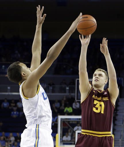 Arizona State forward Jonathan Gilling (31), of Denmark, puts up a shot at three-point range as UCLA guard Kyle Anderson defends in the first half of an NCAA college basketball game in Los Angeles Wednesday, Feb. 27, 2013. (AP Photo/Reed Saxon)
