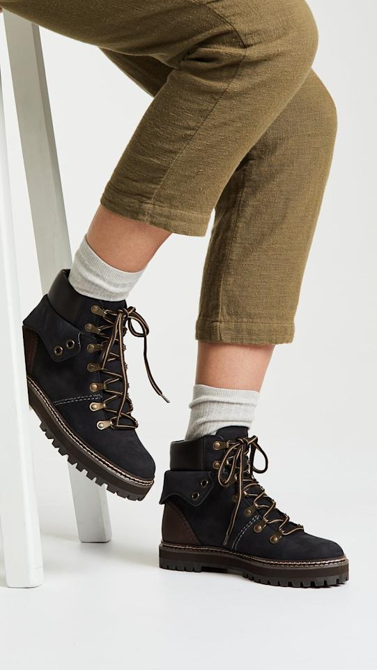 """<p>These <product href=""""https://www.shopbop.com/eileen-flat-boot-see-by/vp/v=1/1511500953.htm?folderID=13468&amp;fm=other-shopbysize-viewall&amp;os=false&amp;colorId=1144E&amp;ref_=SB_PLP_NB_82"""" target=""""_blank"""" class=""""ga-track"""" data-ga-category=""""internal click"""" data-ga-label=""""https://www.shopbop.com/eileen-flat-boot-see-by/vp/v=1/1511500953.htm?folderID=13468&amp;fm=other-shopbysize-viewall&amp;os=false&amp;colorId=1144E&amp;ref_=SB_PLP_NB_82"""" data-ga-action=""""body text link"""">See by Chloe Eileen Flat Booties</product> ($435) can go with you anywhere.</p>"""