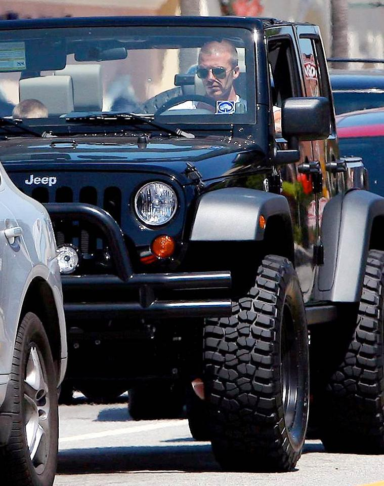 "Just when we thought David Beckham couldn't get any hotter, he hits the streets in his tricked-out black Jeep Wrangler Unlimited. LAX/<a href=""http://www.x17online.com"" target=""new"">X17 Online</a> - May 19, 2008"