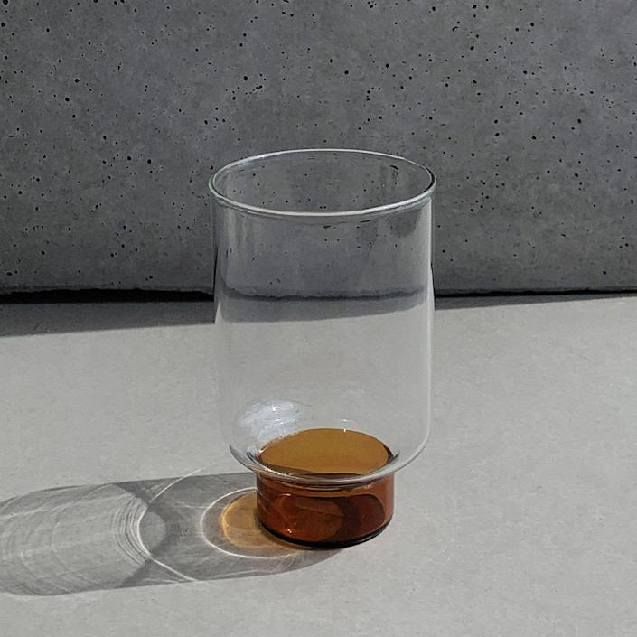 """<p><strong>Aita Amber Base Tall Glass</strong></p><p>hudsonwilder.com</p><p><strong>$20.00</strong></p><p><a href=""""https://hudsonwilder.com/collections/drink/products/aita-amber-base-tall-glass"""" rel=""""nofollow noopener"""" target=""""_blank"""" data-ylk=""""slk:Shop Now"""" class=""""link rapid-noclick-resp"""">Shop Now</a></p><p>Sibling-duo Conway and Joyce Liao launched <a href=""""https://hudsonwilder.com/"""" rel=""""nofollow noopener"""" target=""""_blank"""" data-ylk=""""slk:Hudson Wilder"""" class=""""link rapid-noclick-resp"""">Hudson Wilder</a> with the goal to create timeless tabletop pieces that complement your treasured dinnerware collection. The Brooklyn-based brand's sleek Champagne glasses and hand-painted porcelain dishes flawlessly elevate any tablescape. </p>"""