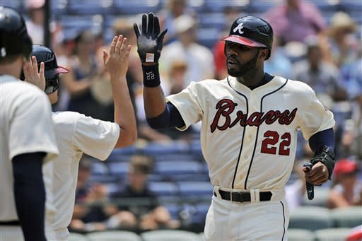 Atlanta Braves' Jason Heyward (22) celebrates with teammates after scoring in the third inning of their baseball game against the Washington Nationals, Sunday, July 1, 2012, at Turner Field in Atlanta. (AP Photo/David Tulis)