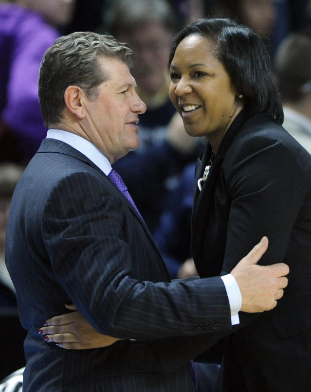 Connecticut head coach Geno Auriemma, left, greets Temple head coach Tonya Cardoza after Connecticut's 80-36 victory in an NCAA college basketball game in Bridgeport, Conn., Saturday, Jan. 11, 2014. (AP Photo/Fred Beckham)