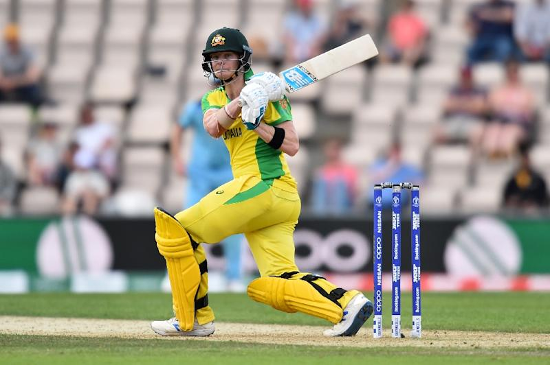 Jeers and cheers - Australia's Steve Smith hits out during his 116 against England in a World Cup warm-up match (AFP Photo/Glyn KIRK                  )
