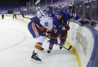 New York Rangers' Ryan Lindgren, right, holds on to New York Islanders' Ross Johnston (32 during the third period of an NHL hockey game Saturday, Jan. 16, 2021, in New York. (Bruce Bennett/Pool Photo via AP)