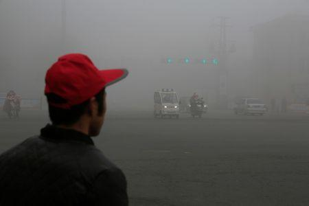 Vehicles travel amid smog on a polluted day in Lianyungang