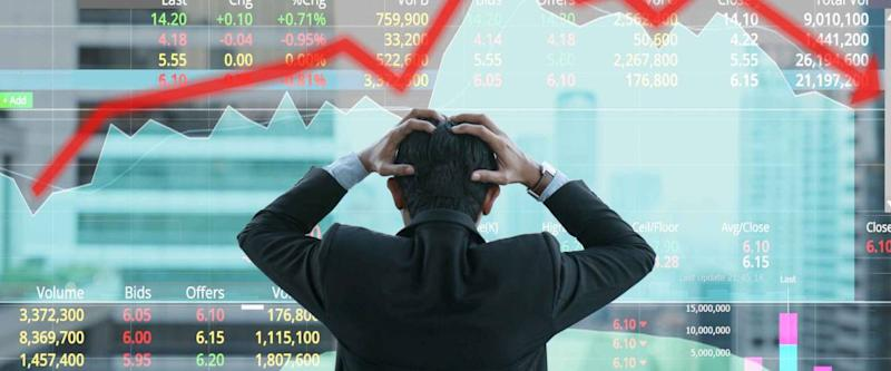 Businessman grabs his head with business chart