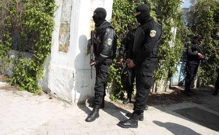 Police officers stand outside parliament in Tunis March 18, 2015. Gunmen attacked Tunisia's national museum near its parliament on Wednesday, killing at least seven tourists and taking others hostage inside the building, the government said. REUTERS/Zoubeir Souissi (TUNISIA - Tags: CIVIL UNREST CRIME LAW TPX IMAGES OF THE DAY)