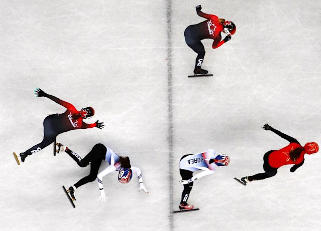 Short Track Speed Skating Events - Pyeongchang 2018 Winter Olympics - Women's 3000 m Final - Gangneung Ice Arena - Gangneung, South Korea - February 20, 2018. Kim Alang of South Korea and Valerie Maltais of Canada fall. REUTERS/John Sibley TPX IMAGES OF THE DAY