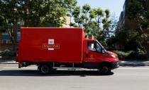 A delivery vehicle drives along a road near Mount Pleasant, in London