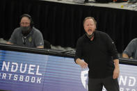 Milwaukee Bucks head coach Mike Budenholzer shouts from the sideline during the first half of an NBA basketball game against the Brooklyn Nets Tuesday, May 4, 2021, in Milwaukee. (AP Photo/Aaron Gash)