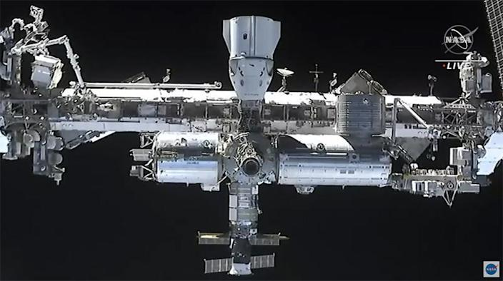A camera in the nose of the Crew Dragon capsule captures a detailed view of the space station during final approach, including a look at another already-docked Crew Dragon that carried four astronauts to the lab last November. / Credit: NASA TV