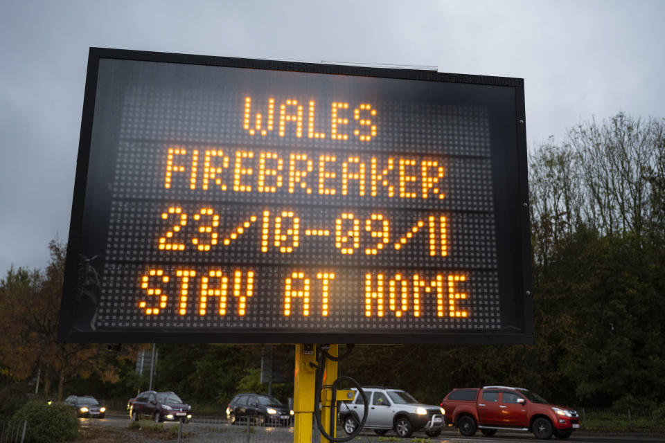 "CARDIFF, WALES - OCTOBER 21: A sign warns of the Wales ""firebreaker"" lockdown which starts on October 23 and ends on November 9 on October 21, 2020 in Cardiff, Wales. Wales will go into a national lockdown from Friday until November 9. People will be told to stay at home and pubs, restaurants, hotels and non-essential shops must shut. Primary schools will reopen after the half-term break, but only Years 7 and 8 in secondary schools can return at that time under new ""firebreak"" rules. Gatherings indoors and outdoors with people not in your household will also be banned. (Photo by Matthew Horwood/Getty Images)"