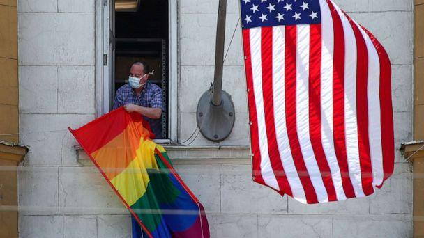 PHOTO: The US national flag and an LGBT pride flag on the front facade of the US Embassy in Moscow, June 25, 2020. (Valery Sharifulin/TASS, FILE)