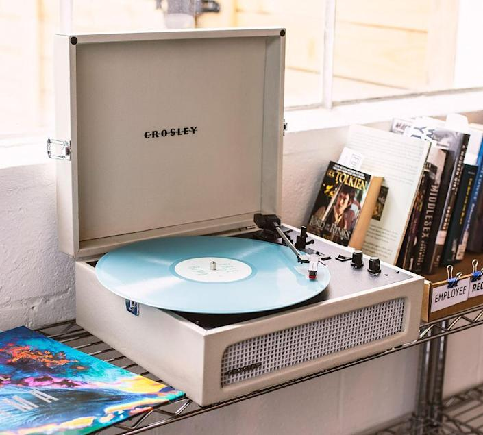 """Even if he prefers listening to his music on vinyl, this handsome Crosley record player has Bluetooth capabilities to play songs from smartphones or tablets as well. $80, Pottery Barn. <a href=""""https://www.potterybarn.com/products/crosley-voyager-turntable-mp/?"""" rel=""""nofollow noopener"""" target=""""_blank"""" data-ylk=""""slk:Get it now!"""" class=""""link rapid-noclick-resp"""">Get it now!</a>"""