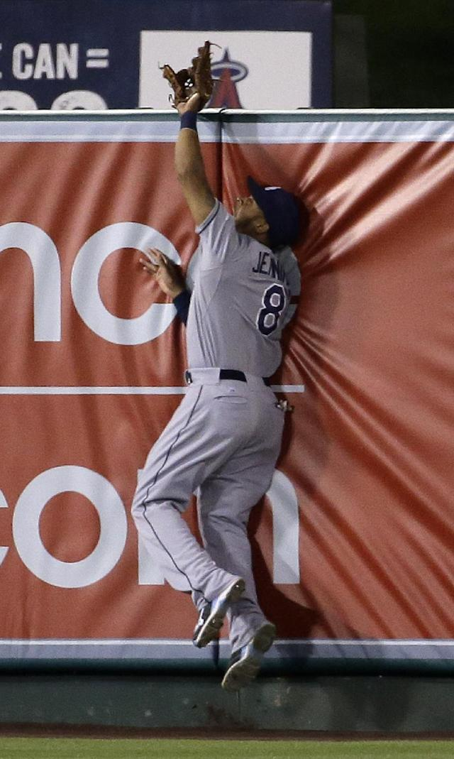 Tampa Bay Rays center fielder Desmond Jennings robs Los Angeles Angels' Collin Cowgill of a home run at the wall during the fourth inning of a baseball game in Anaheim, Calif., Thursday, May 15, 2014. (AP Photo/Chris Carlson)