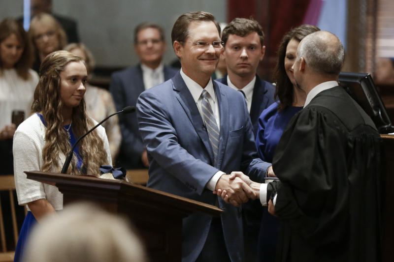 Rep. Cameron Sexton, R-Crossville, center, is congratulated after being sworn in as House Speaker during a special session of the Tennessee House Friday, Aug. 23, 2019, in Nashville, Tenn. (AP Photo/Mark Humphrey)