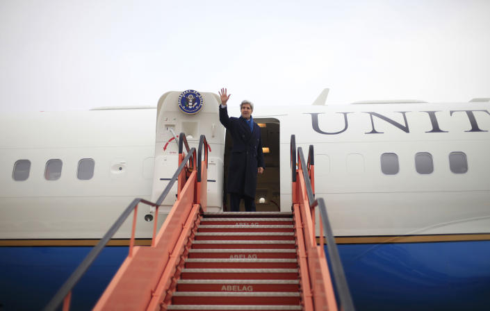 US Secretary of State John Kerry waves as he boards his plane at Brussels National Airport, Wednesday, Dec. 4, 2013. Kerry traveled to Belgium to attend the annual meeting of NATO foreign ministers and is continuing his travel with a stop in Moldova before heading to Israel today. (AP Photo/Pablo Martinez Monsivais, Pool)