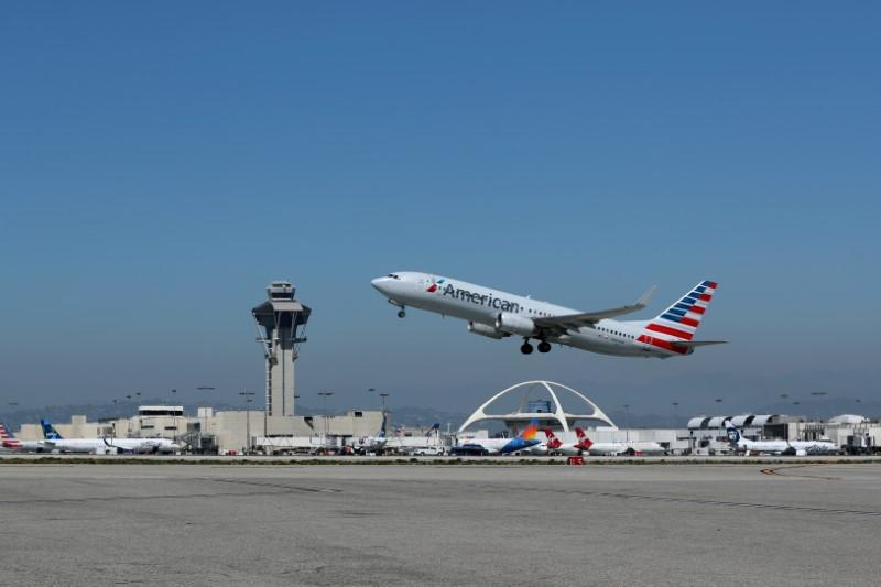 FILE PHOTO: An American Airlines Boeing 737 plane takes off from Los Angeles International airport