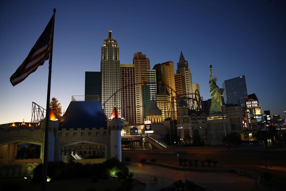FILE - In this April 28, 2020, file photo, the sun sets behind casinos and hotels along the Las Vegas Strip in Las Vegas. Two prominent Las Vegas communications executives are suing more than 20 online travel companies for back taxes they say should have been paid to Nevada based on hotel room rates.(AP Photo/John Locher, File)