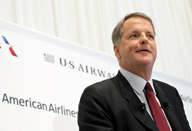U.S. Airways CEO Doug Parker announces the planned merger of AMR Corp, the parent of American Airlines, with U.S. Airways during a news conference at Dallas-Ft Worth International Airport in this February 14, 2013, file photo. REUTERS/Mike Stone/Files   GLOBAL BUSINESS WEEK AHEAD PACKAGE - SEARCH 'BUSINESS WEEK AHEAD MARCH 28'  FOR ALL IMAGES