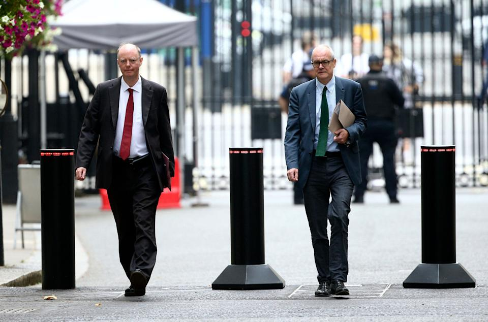 <strong>The government's chief medical officer Chris Whitty, left, and chief scientific adviser Patrick Vallance arrive in Downing Street, London, Monday Sept. 21, 2020. </strong> (Photo: ASSOCIATED PRESS)