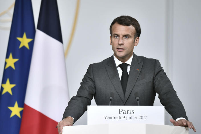 French President Emmanuel Macron delivers his speech during a press conference after a video summit with leaders of G5 Sahel countries at the Elysee presidential Palace in Paris, Friday July 9, 2021. French President Emmanuel Macron said Friday his country will withdraw more than 2,000 troops from an anti-extremism force in Africa's Sahel region starting in the coming months. Macron announced last month a future reduction of France's military presence, arguing that the current operation is no longer adapted to the need. (Stephane de Sakutin, Pool photo via AP)